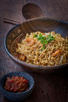 An easy step by step version of Mie Goreng.  For those days when you have a craving for the dish you got tired of eating while in Indonesia :0)  I would add some crushed up Thai peppers to spice it up and of course add a fried or scrambled egg to the top.  I used chopped up pine nuts in place of candlenuts.