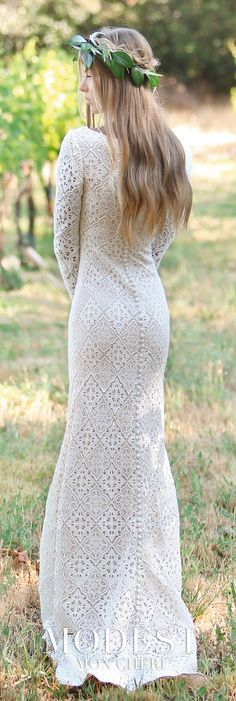 Modest Wedding Dresses TR11832 - Allover Venise lace sheath with long sleeves, bateau neckline, natural waistline, covered buttons on the inner lower arm, and covered buttons that trail down the center back through the skirt to the hem of the sweep train.