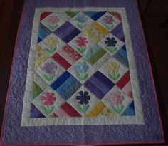 I checked out Daisy Applique Baby Quilt - Handmade on Lish, $55.00 USD