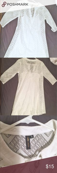 White chevron lace dress Brand new without tags!  Selling this super cute chevron lace dress, size small.  Worn only once to try on.  The dress is made up of a white cami slip under a white dress with a chevron pattern.  The outer dress has 3/4 length sleeves and a lace up v-neck.  Originally purchased for sorority initiation but passed it up in favor of another dress.  Would make a great outfit for initiation, church, spring and summer, and so on.  Open to offers! Dresses