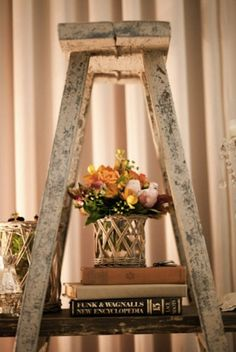 Older items that may not be safe to use anymore for their original purpose can be turned into decorations or displays. Place wooden planks across an old wooden ladder for a makeshift table or shelf.