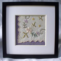 Corner of hand embroidered silk hankie meticulously machine quilted...placed on top of lavender Dupioni silk.