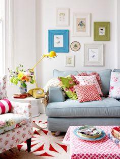 English cottage prints, blue sofa, bright accent colors