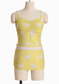 Sunshine Splendor One Piece Bathing Suit 79.99 at shopruche.com. Designed with old Hollywood glamor, this vintage-inspired one piece  bathing suit is like a ray of sunshine in vibrant yellow. Finished with a charming white polka dot print, feminine  ruched details, removable bust cups, and the...