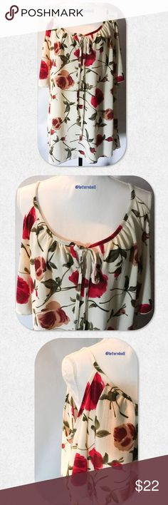 """Free Kisses Plus Size Cold Shoulder Top Such a beautiful floral top! Size 2X (22/24). Pair with capris and sandals and you're ready for a day at the park! Cold shoulder, spaghetti straps. Ties at the neck. Sexy and trendy! Measurements taken laying flat.   B: 23"""" L: 30"""" Free Kisses Tops Blouses"""