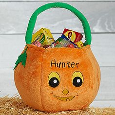 Personalized Pumpkin Trick or Treat Bag for Halloween - this is adorable!! You can embroider it with any name for free!