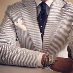 I love everything about this outfit, the seersucker blazer to the polka dot tie, and I'd team navy tailored trousers with this.