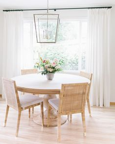 Love these Balboa Side Chair - Serena & Lily paired with a round kitchen table and lantern chandelier. Dining Room Design, Dining Room Table, Dining Area, Rattan Dining Chairs, White Dining Chairs, Kitchen Chairs, Home Renovation, Drapery Designs, Sweet Home