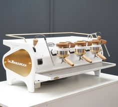 White, brass and handcrafted American oak La Marzocco Strada