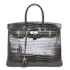 You really have to see this one in person to see how beauteous she is!  HERMES Porosus Crocodile BIRKIN 35 Graphite.