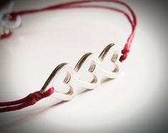 Sterling Love, love, love bracelet on red linen.  Perfect for Mom's Day! $22 from JewelryByMaeBee on Etsy.
