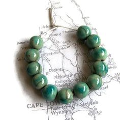 9 Handmade Raku Ceramic Beads African Beads by EarthbutterStudio, $14.00
