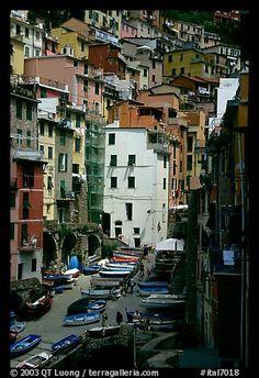 Plazza with parked boats built along steep ravine, Riomaggiore. Cinque Terre, Liguria, Italy. From Terra Galleria