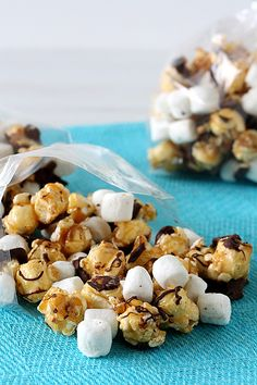 S'mores Caramel Popcorn (caramel popcorn, mini marshmallows, graham cracker crumbs, melted chocolate drizzled over)