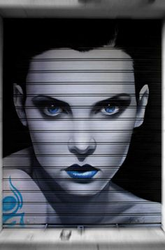 Graffiti de retratos hechos por Man o Matic