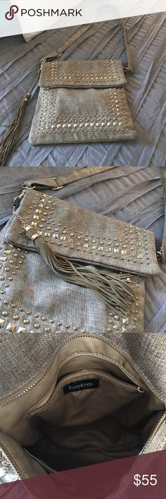 Bebe crossbody Metalc gold with studs, beautiful and lots of space! Very clean. bebe Bags Crossbody Bags