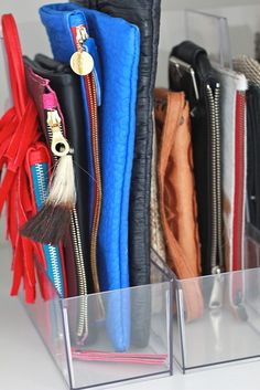 store clutches, wallets, and pouches in clear acrylic magazine files --- VISIT http://stylewarez.com