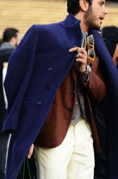 Shop this look on Lookastic:  http://lookastic.com/men/looks/chinos-blazer-overcoat-waistcoat-watch-sunglasses-tie-dress-shirt/8810  — Beige Chinos  — Brown Wool Blazer  — Navy Overcoat  — Brown Plaid Wool Waistcoat  — Gold Watch  — Tan Sunglasses  — Grey Wool Tie  — Light Blue Dress Shirt