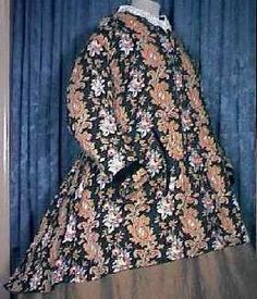 A lady's circa 1860's paisley paletote. Deep true printed colors of paisley both forms and roses with violet colored leaves on a black background.