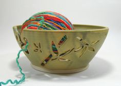 I have a gorgeous yarn bowl Hubbs bought for me.  It keeps your yarn from escaping and traveling all over the room when you're stitching like a wild person.