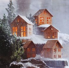 Christmas decor: Snowy Mountain Cabins Holiday Houses - Scandinavian modern style in Cinnamon Wood. (Borax crystal the roofs.try covering some houses fully in crystal mixture) Christmas Village Houses, Christmas Town, Putz Houses, Christmas Villages, Rustic Christmas, Christmas Diy, Xmas, Vintage Christmas, Decorating With Christmas Lights