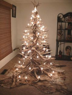 Antler Tree! This is actually really cool! Not for a main tree of course but maybe for decoration in a finished basement or something!