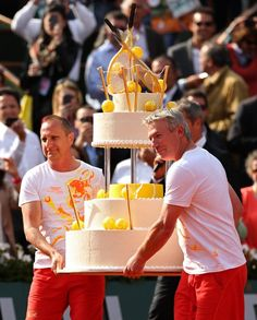2013 French Open - Day Nine. PARIS, FRANCE - JUNE 03: A giant birthday cake is carried onto the court for Rafael Nadal of Spain after his victory in the Men's Singles match against Kei Nishikori of Japan during day nine of the French Open at Roland Garros on June 3, 2013 in Paris, France. (Photo by Matthew Stockman/Getty Images)
