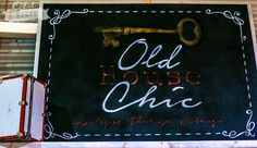 Vintage Chalkboard with Old House Chic logo for the Vintage Whites Market.