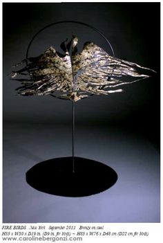 """Art studio glimpse: #Steel sculpture by #Caroline Bergonzi.  """"In #FIREBIRDS another type of transformation occurs, that I cannot explain beside """"this is how it worked."""" Wings again, bird silhouettes, clear this time, in a shape we have seen before in my #paintings.C.B. Extract of the """"Caroline Bergonzi Creative Odyssey"""" 400-page art book, available on #Amazon."""