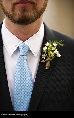 boutonniere using wax flower wrapped with jute twine with exposed stems