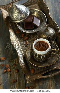 Beautiful bronze set for Turkish coffee on the old table. by SMarina, via Shutterstock