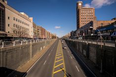 The Grand Concourse: The middle lanes of the Grand Concourse emerge from their dip beneath East Fordham Road.