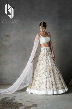 Looking for White and gold lehenga? Browse of latest bridal photos, lehenga & jewelry designs, decor ideas, etc. on WedMeGood Gallery. Indian Lehenga, Gold Lehenga, Net Lehenga, Bridal Lehenga Choli, Anarkali, Lehenga White, Floral Lehenga, Lehenga Choli Designs, Indian Wedding Outfits