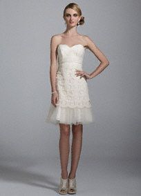 A perfect look to create a vintage inspired theme, you will be unforgettable in this timeless wedding dress! Strapless bodice with ultra-feminine sweetheart neckline. Short tulle and lace tiered skirt features tulle flounce detail on hem of skirt. David's Bridal.