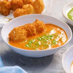 Tomato soup Happiness is deep-fried balls of cheese, floating in a bowl of warm creamy soup. Mmmm.