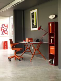 Cement flooring. Spoon table and chair by Antonio Citterio with Toan Nguyen | Orange touch!