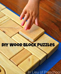 DIY wood block puzzles for kids - put painters tape down and have them fill it in.