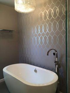 A DIY metallic stenciled bathroom accent wall using the