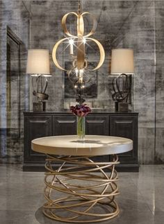 grand table! glamorous foyer, taupe, gold, charcoal color scheme, sculptural chandelier