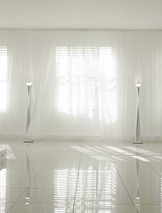 Shutters and sheer curtains