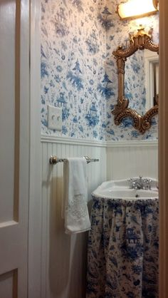 Beadboard and blue toile powder room via The Enchanted Home