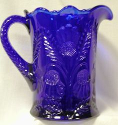 "This Cobalt Blue ""Inverted Thistle"" Pattern Pitcher holds 24 oz. It is American Handmade Glassware."