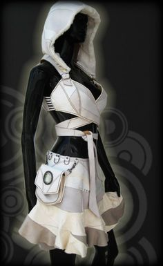 Like the ring tabs at the waist. White 007 Leather Wrapping Top, Reversible, Detaching Hood. via Etsy.