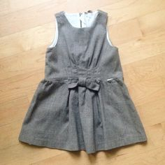 """Adorable Muffin and Co dress Perfect for the HOLIDAYS!! Adorable girls Italian designer Muffin and Co Lambs Wool dress.  Fully lined. Girls Size 5. Made in Italy. Length measures:  back neck line to bottom hem 21"""". Waist to hem 10"""" Muffin and Co Dresses"""