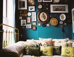From thisisloveforever.com. Love the mix of shapes and sizes of the frames and the vintage feel. And of course, the turquoise wall!