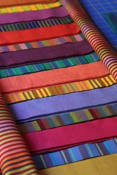 Beautiful Kaffe Fassett shot cottons and stripes from Invisible Woman blog. Love those scrumptious colors and strips of fabric ready to be sewn.