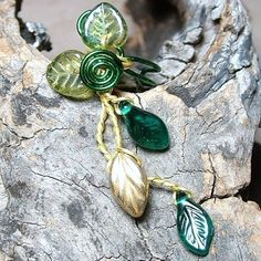Green and gold woodland ear cuff -perfect for a forest fae:)  EAR CUFF NOTES:  Designed to fit any ear, Thyme2dream ear cuffs are adjustable and can be worn with or without regular earrings- No piercing needed!  Our wire is nickel free and has a non-tarnish coat that makes it easy to wear even