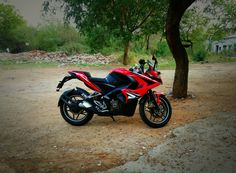 Red Beast!! #Busy #Bajaj #PulsarRS200 #Pulsar #FastestIndian #sportsbikelife #sportsbike #India #Indian #Love #Ride #Summer  #FunTime #Friday #TGIF #Rider #Hot #Iphone #Moto #MotoXStyle #Style #Life #Fashion #Wheels #Adventure #Trees #Shades #FreedomRide #Happiness #Peace