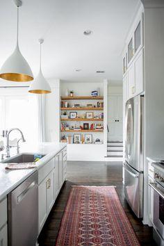 open, all-white kitchen