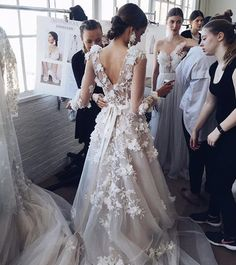 Feeling the real flower-power of @marchesafashion Collection Discover more wow-factor #weddingdresses on The Wedding Diary ✔️ #TWDmag www.weddingdiary.org.uk